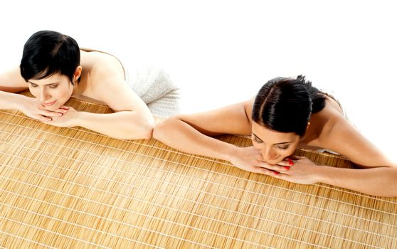 Portrait of young beautiful women in spa environment