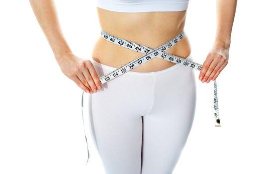 Slim female showing her body