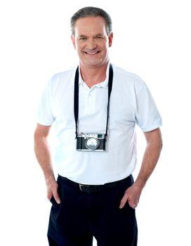 Mature cameraman posing smartly