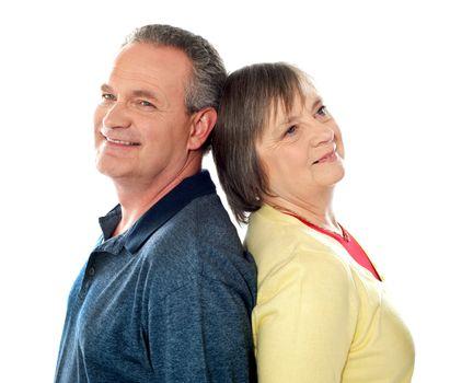 Closeup shot of aged couple, back to back