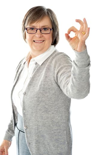 Old lady showing excellent gesture
