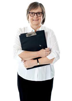 Portrait of senior businesswoman holding reports