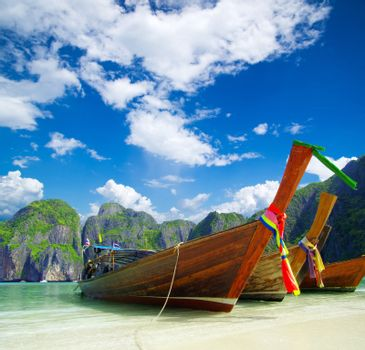 beach, longtail boats,