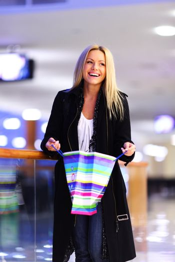 woman in shop center holds the bag in hands