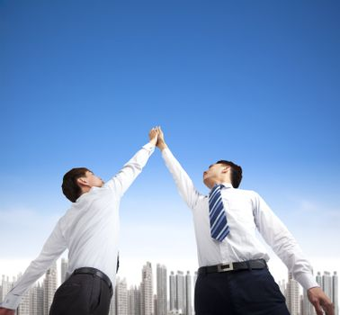 two businessmen with success gesture