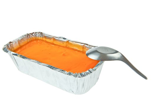 Butter cake topping with jelly orange and a spoon