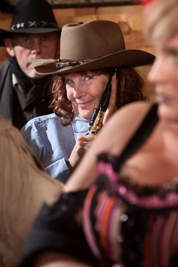 Smiling Cowgirl with Pistol