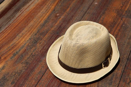 Beautiful traditional Panama hat on wooden background