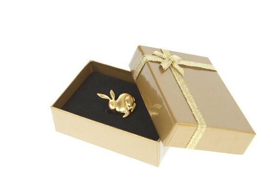 Golden rabbit in a gift box with golden ribbon isolated on white
