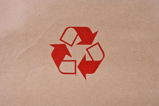 Recycled Symbol on Brown Paper