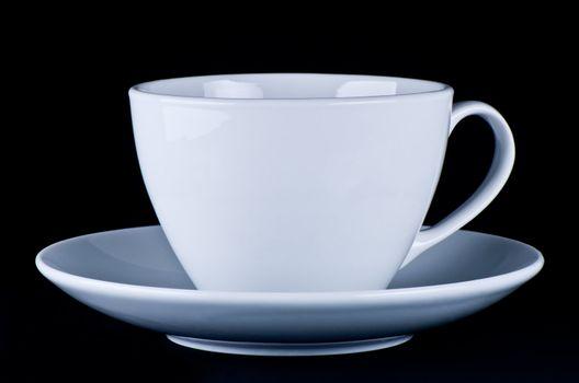 White mug on saucer