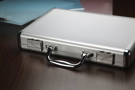silver brief case on the table top
