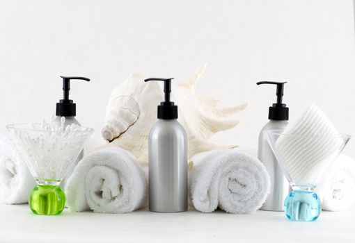 Various professional spa products arranged on a white background