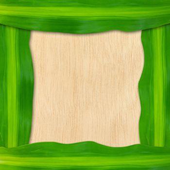 green leaves frame on wood background