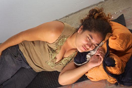 Young Peruvian Woman Squatting