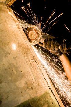 Man hand holding spinning circular saw