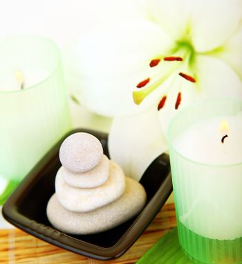 Spa candle and stones