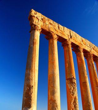 Jupiter's temple columns over blue sky