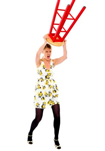 Frustrated woman breaking stool