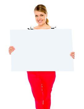 Pretty lady displaying blank placard