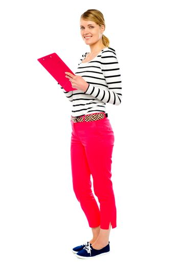 Woman standing with clipboard