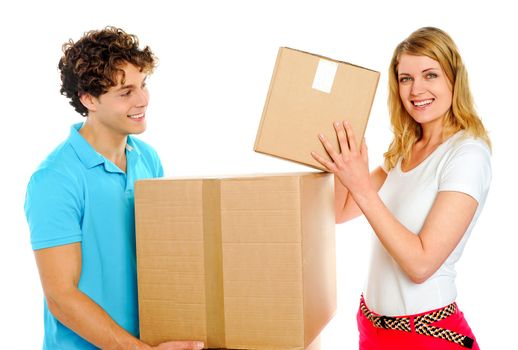 Couple arranging cardboard boxes