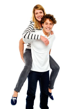 Boy piggybacks his girlfriend