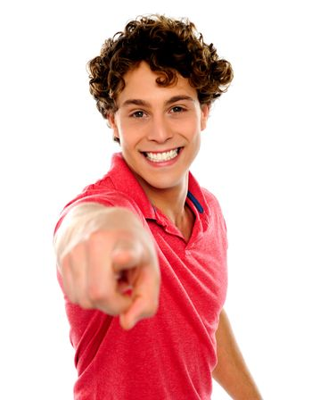 Handsome curly hair teen pointing at you