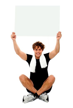 Handsome athlete holding blank placard