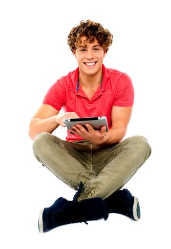 Portrait of a boy using a tablet computer