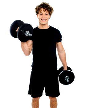 Smiling muscular man doing exercise