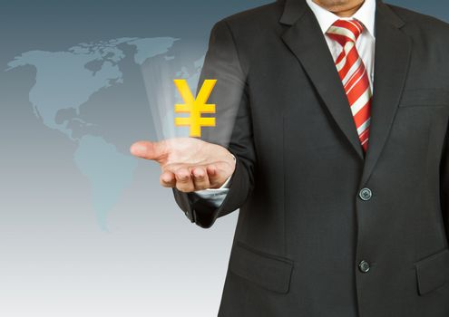 Businessman with Yen symbol over his hand