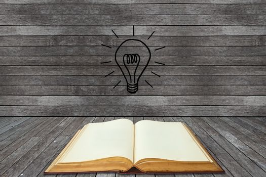 Book and lightbulb in a wood room