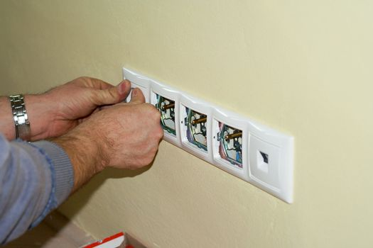 Electrician completes the socket at 230 volts