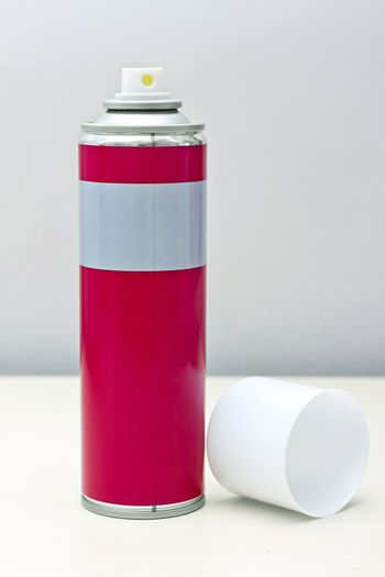 reddish gray with a white spray can lid