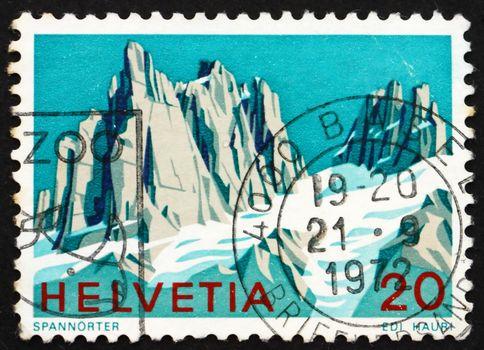 SWITZERLAND - CIRCA 1972: a stamp printed in the Switzerland shows View of Spannorter, Swiss Alps, circa 1972