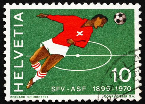 SWITZERLAND - CIRCA 1970: a stamp printed in the Switzerland shows Soccer Player, 75th Anniversary of Swiss Soccer Association, circa 1970