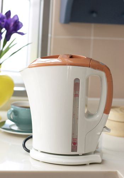 An orange boiler on the table.