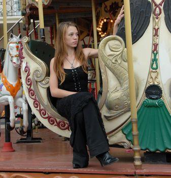 teen in a carousel