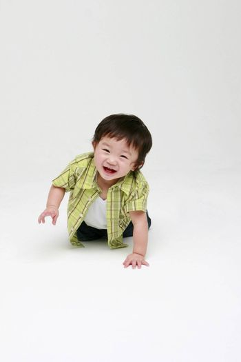 Cute happy toddler smiling at the camera