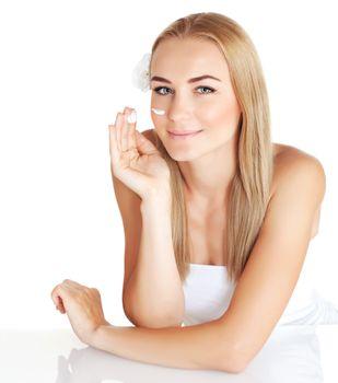Woman apply anti wrinkle cream