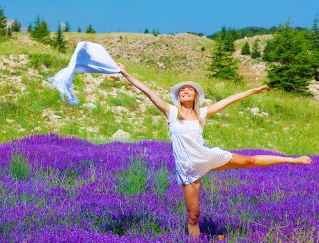 Woman dance on floral field