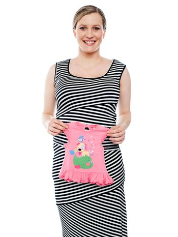 Young mum showing pink baby cloth to camera