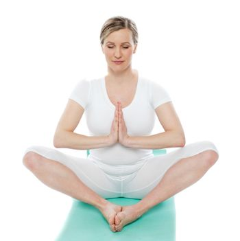 Blonde lady meditating in white