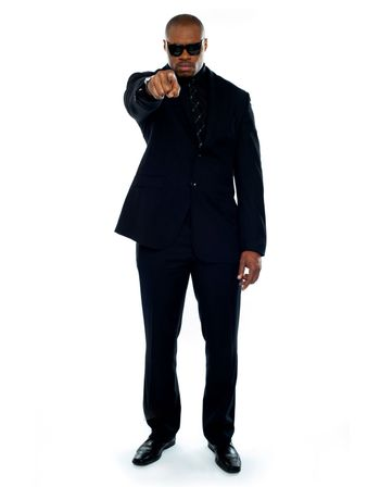 Businessman pointing at you. Full-length portrait