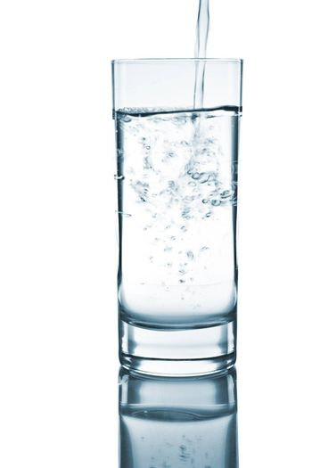 mineral water being poured into a glass