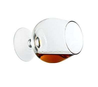 Cognac in the big glass on a white background
