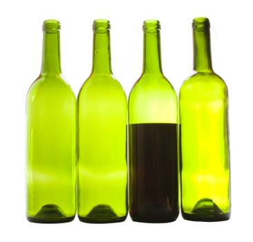 Wine bottles close-up isolated over white background