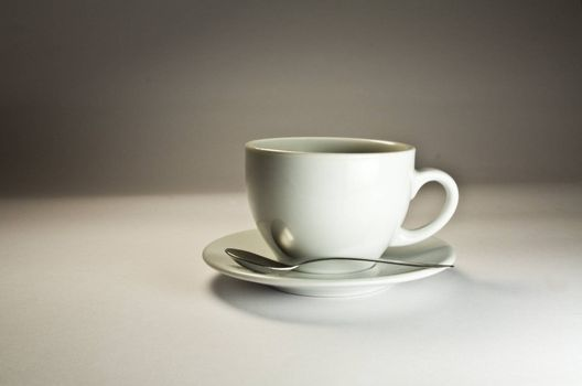 Coffee cup on a grey background. Studio