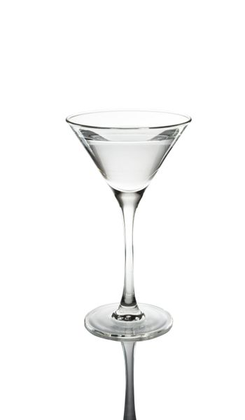 Glass of martini with reflexion on a white background